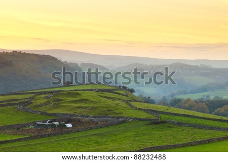A landscape shot of the Peak District in Derbyshire at sunset.
