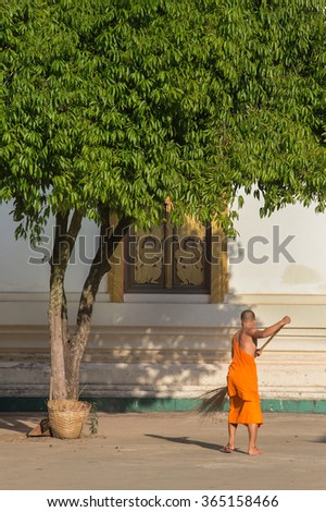 A Lao Monk of Buddha working in temple  Vientiane , Laos - stock photo