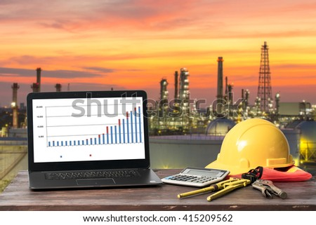 A laptop with the construction of oil - stock photo