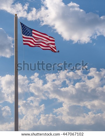 A large American flag, waving in the breeze in El Reno, OK.