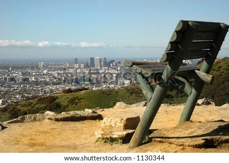 A large bench in Runyon Canyon overlooks Los Angeles - stock photo