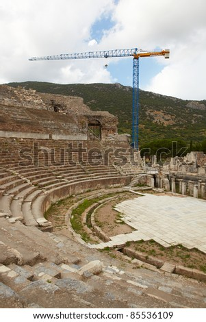 A Large Blue Crane reconstructing the remains of the large Amphitheater (Coliseum) in the city of Ephesus in modern day Turkey