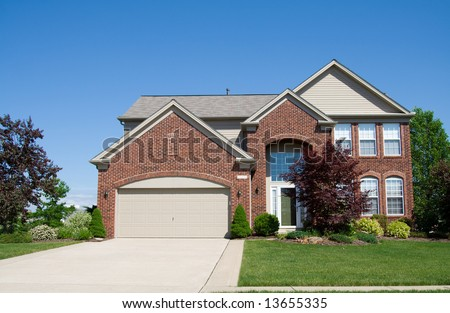 A large brick house in the suburbs in Ohio USA. - stock photo