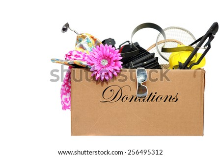 A large cardboard box filled with donations for a charity or good cause. isolated on white with room for your text. donations are used by the needy around the world. - stock photo