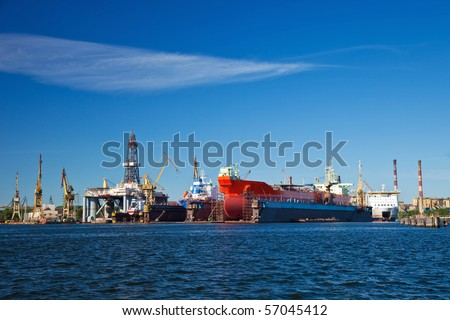 A large cargo ship is being renovated in shipyard Gdansk, Poland. - stock photo