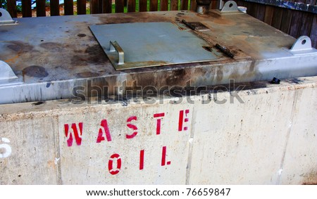 a large collection bin of waste oil - stock photo