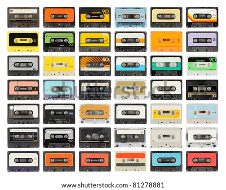 a large collection of retro cassette tapes places in a grid - stock photo