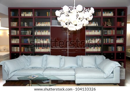 a large comfortable living room with lots of lights - stock photo