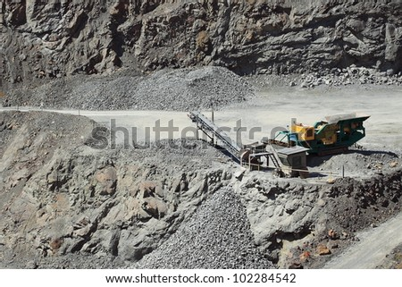 A large conveyor belt in the stone mine - stock photo