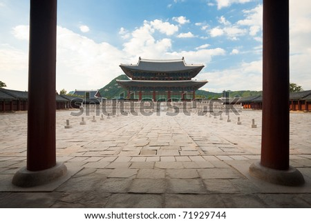 A large courtyard houses the Geunjeongjeon, the royal throne at the Gyeongbokgung Palace in Seoul, South Korea. - stock photo