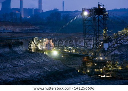 A large excavator digging in a brown-coal mine - stock photo