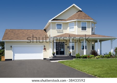 A large family home in the suburbs. - stock photo