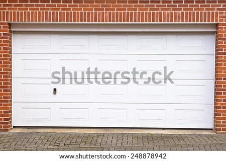 A large garage door in a home - stock photo