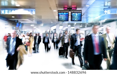 A large group of arriving businessmen. Panorama. Motin blur. - stock photo