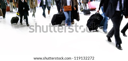 A large group of people walking. Hurrying passengers. Motion blur. - stock photo