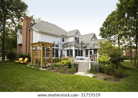 A large house with landscaped backyard in the suburbs
