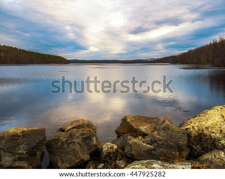A large lake in the forest in autumn