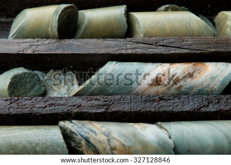 a large library of drilled core samples used by geologists to determine ore quantity and quality - stock photo