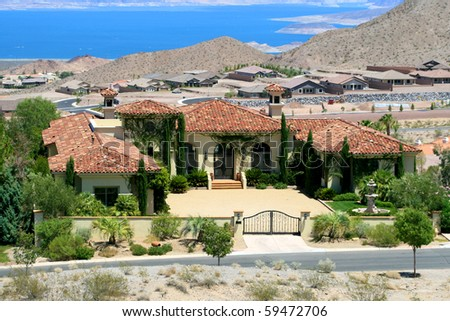 A large luxurious house on a hill with a view of Lake Mead - stock photo