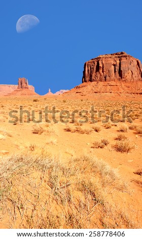 A Large moon over Monument Valley Arizona - stock photo