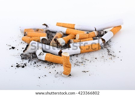 a large number of cigarettes with orange filter extinguished on a white isolated background