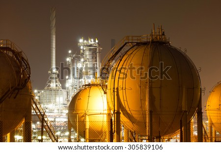 A large oil-refinery plant with Liquefied Natural Gas (LNG) storage tanks - stock photo