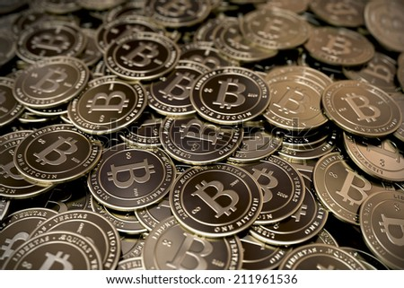 A large pile of bitcoins stacked on top of each other. - stock photo