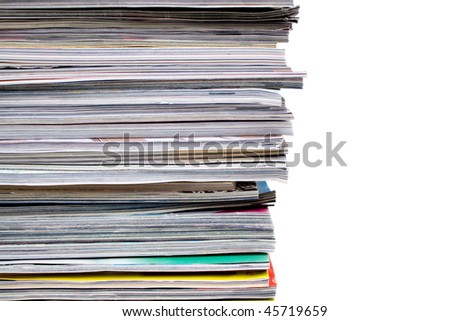 A large pile of magazines stacked high. Isolated over white with copyspace. - stock photo