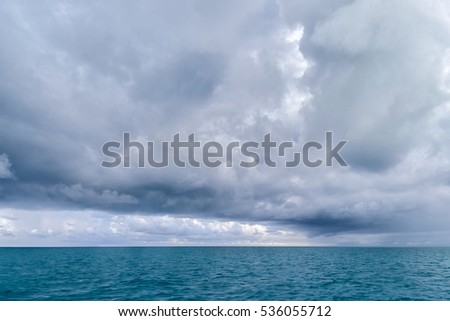 A large rain storm brews in the open waters between Key west and the Dry tortugas seventy miles out in the Gulf of Mexico