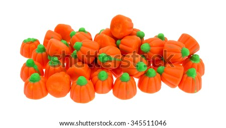A large serving of orange and green Halloween pumpkin candy isolated on a white background. - stock photo