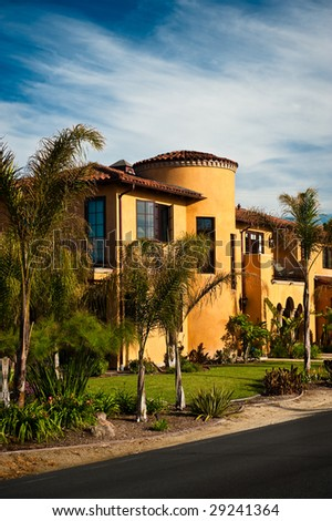A large Spanish Colonial style California home. - stock photo