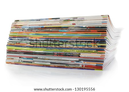 A large stack of magazines. On a white background with shadow. - stock photo