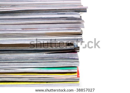 A large stack of magazines piled high.  Isolated over white with copyspace. - stock photo