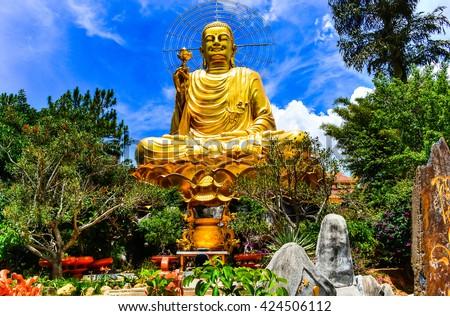 A large statue of golden Buddha. Dalat Vietnam - stock photo