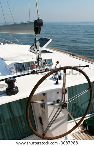 A large steering wheel on a yacht - stock photo