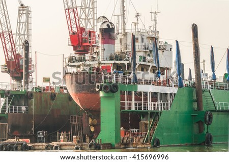 A large tanker ship is being renovated in shipyard Gdansk, thailand - stock photo