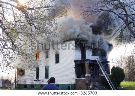 A large three story home in Detroit on fire - stock photo