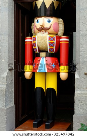 A large traditional toy soldier figurine in Rothenburg ob der Tauber, Germany.  It is one of the best-preserved medieval towns in Europe, part of the famous Romantic Road tourist route.  - stock photo