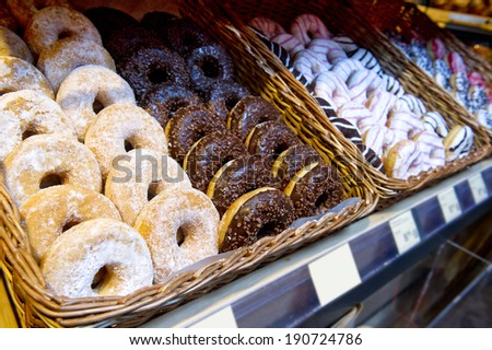 a large variety of donuts in the store and on the market - stock photo
