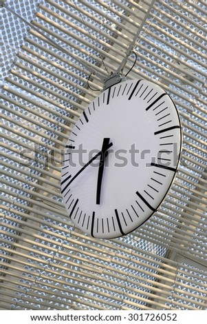 A large white analogue clock standing on 6:40