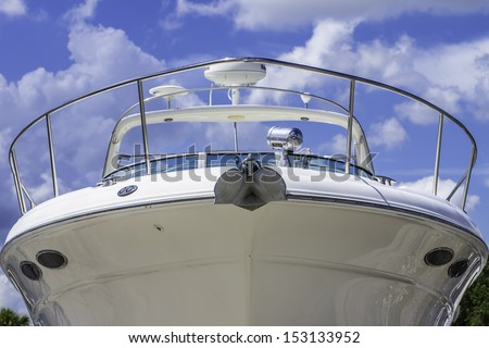 A large white boat shot of the front of the bow. - stock photo