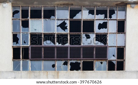 A large windows broken with old jail building - stock photo