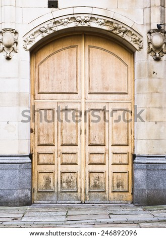 A large wooden arch doorway - stock photo