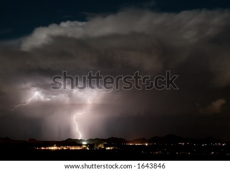 A late night thunderstorm over the Roskruge Mountains