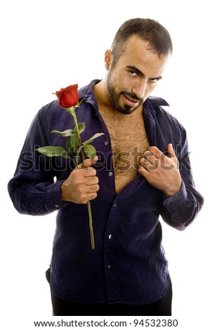 A latin guy with rose with a seductive look. - stock photo