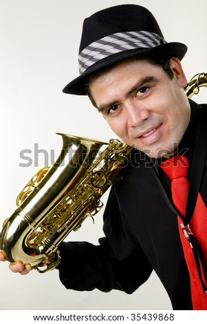 A latino saxophone player with his instrument isolated on white.