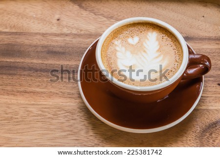 A Latte Coffee art on the wooden desk