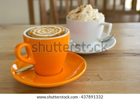 A Latte Coffee art on the wooden desk. - stock photo
