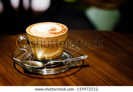 A Latte Coffee at the desk - stock photo