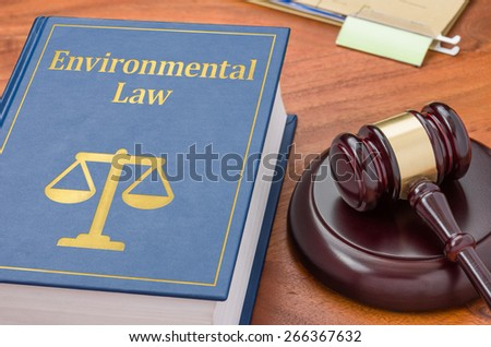 A law book with a gavel - Environmental law - stock photo